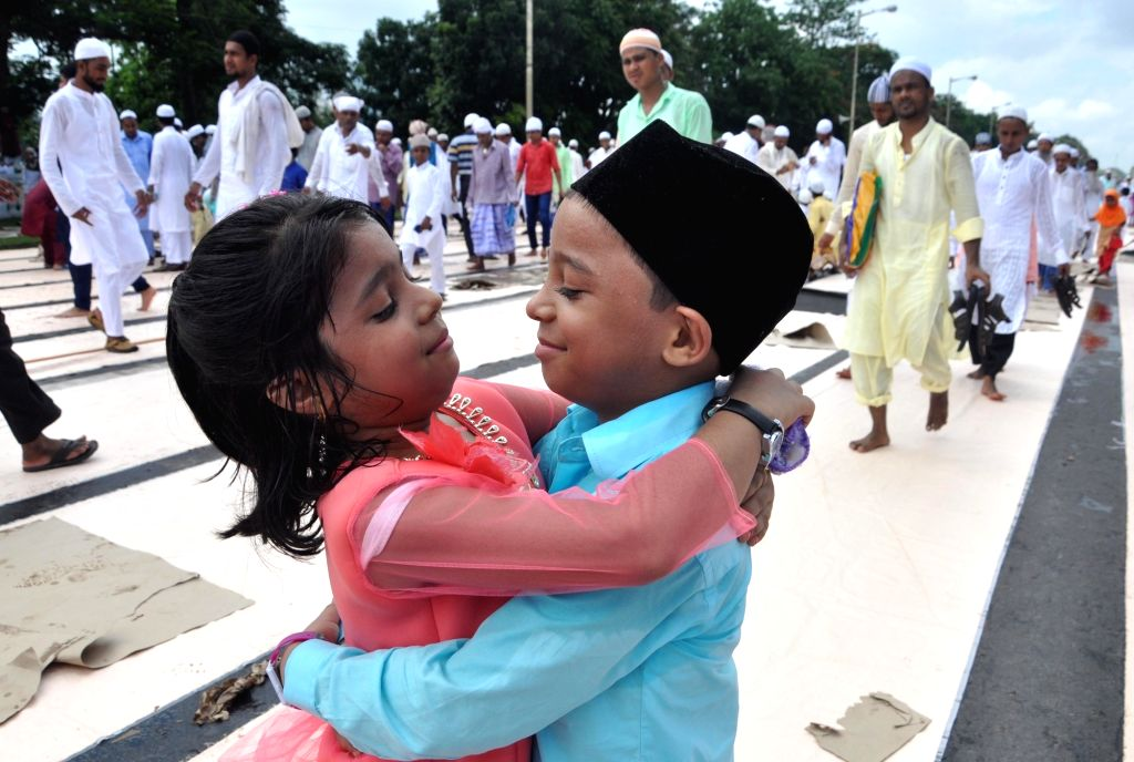 Muslims offer greetings after prayers of the occasion of Eid-ul-Fitr at Red Road in Kolkata on June 26, 2017.
