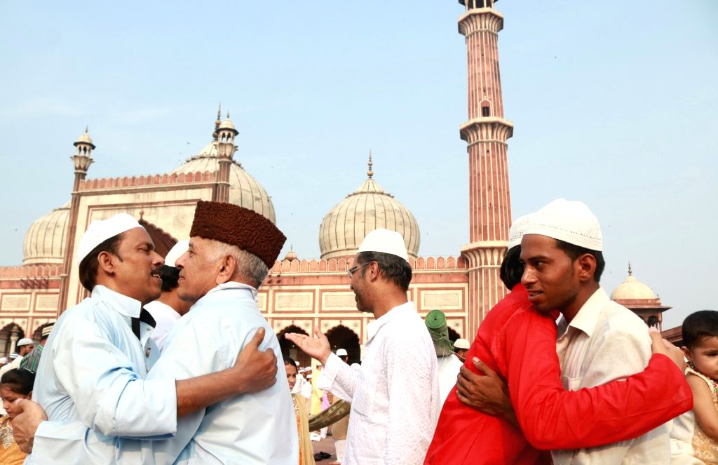Muslims offer greetings after the prayer on the occasion of Eid-ul-Fitr, at Jama  Masjid in New Delhi on June 26, 2017.
