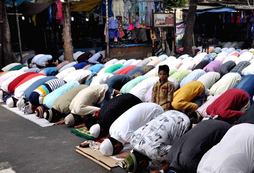 Muslims offer namaz on Ramadan outside Tipu Sultan Mosque in Kolkata on June 16, 2017.