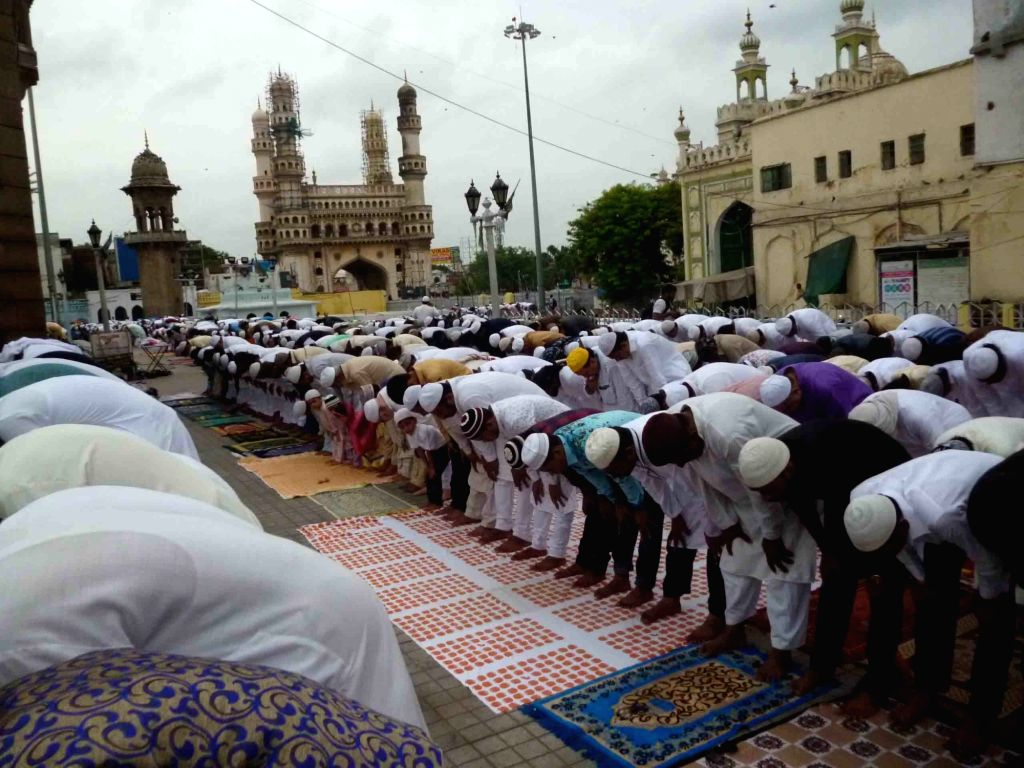 Muslims offer prayer on the occaasion of Eid ul Fitr, at the Macca Masjid in Hyderabad on June 26, 2017.