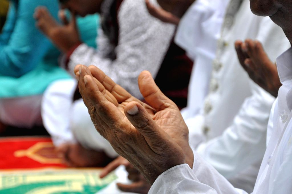 Muslims offer prayer on the occasion of Eid-ul-Fitr at Nakhoda Masjid in Kolkata on June 26, 2017.