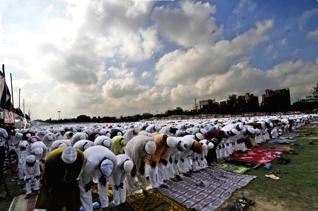 Muslims offer prayer on the occasion of Eid ul Fitr in Patna on June 26, 2017.