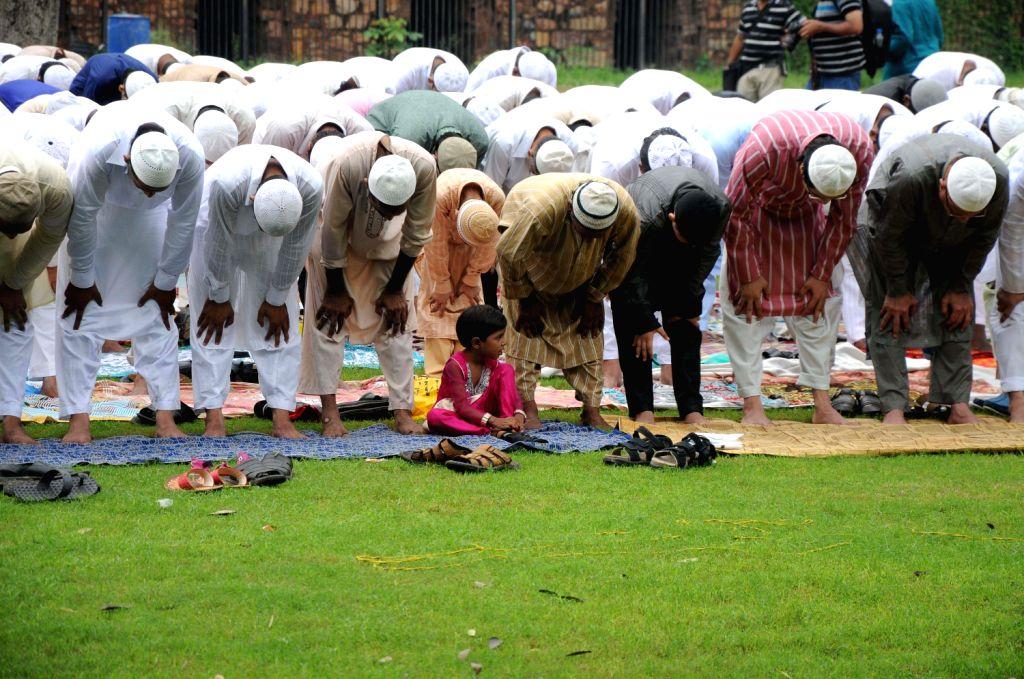 Muslims offer prayer on the occasion of Eid ul-Fitr at Feeroz Shah Kotla in New Delhi on August 9, 2013.