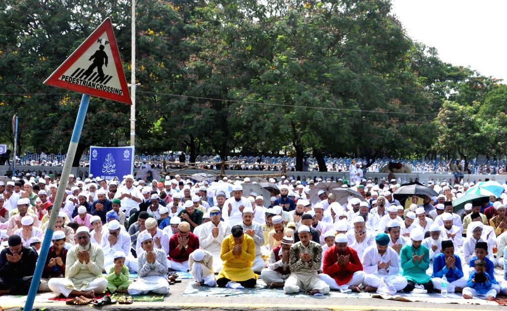Muslims offer prayers of the occasion of Eid-ul-Fitr at Red Road in Kolkata on June 26, 2017.