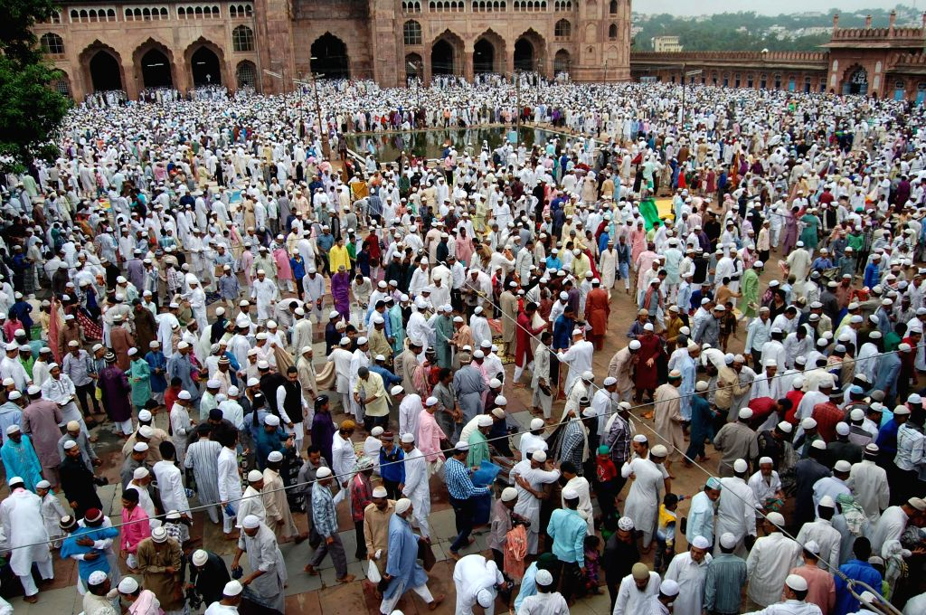 Muslims offer prayers on occassion of Eid-ul-Fitr in Bhopal on July 29, 2014.