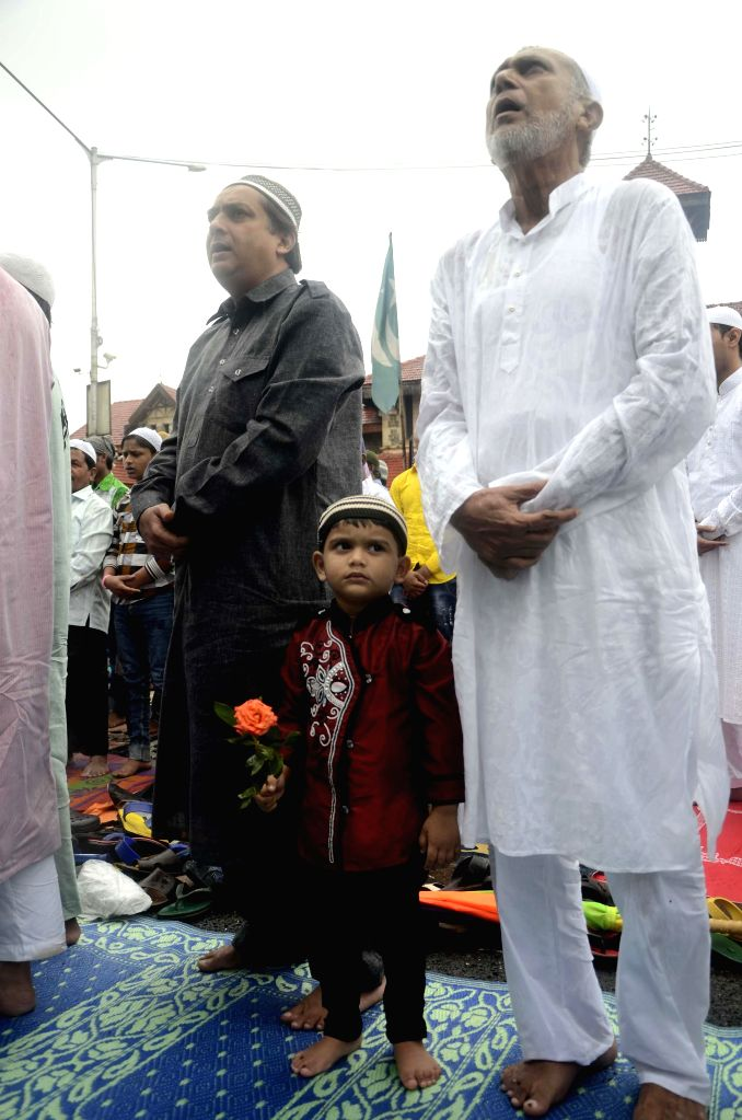 Muslims offer prayers on occassion of Eid-ul-Fitr in Mumbai on July 29, 2014.