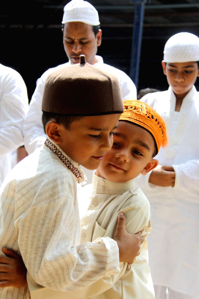 Muslims offer prayers on the occasion of Eid ul -Fitr in Bangalore on July 29, 2014