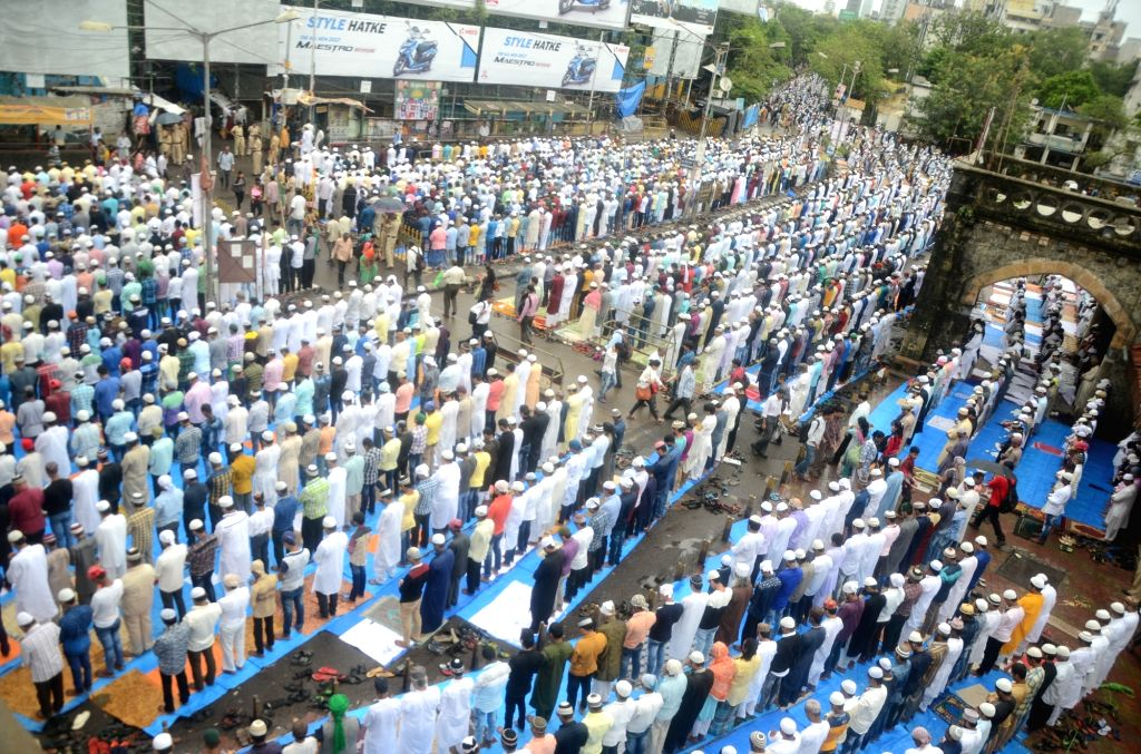 Muslims offer prayers on the occasion of Eid-ul-Fitr in Mumbai on June 26, 2017.