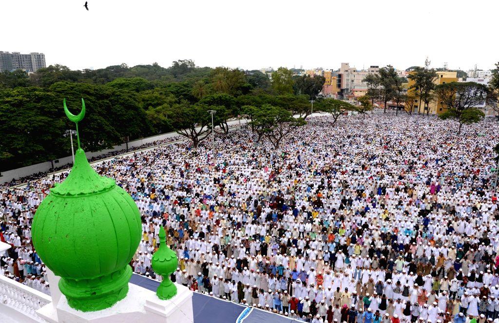 Muslims offer prayers on the occasion of Eid-ul-Fitr at Idga Maidan in Bengaluru on June 26, 2017.