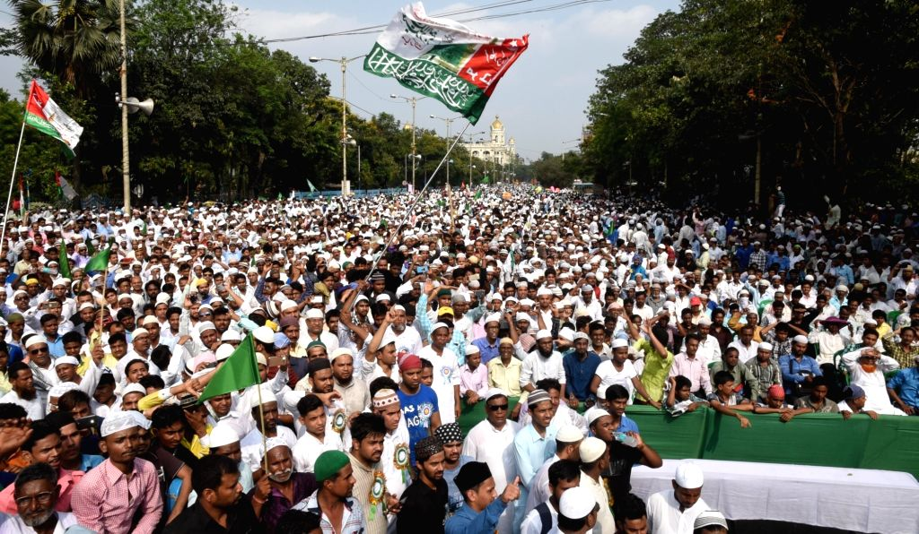 Muslims participte during a protest rally against Sonu Nigam's controversial remarks on use of loudspeakers for religious reasons in Kolkata on April 21, 2017.