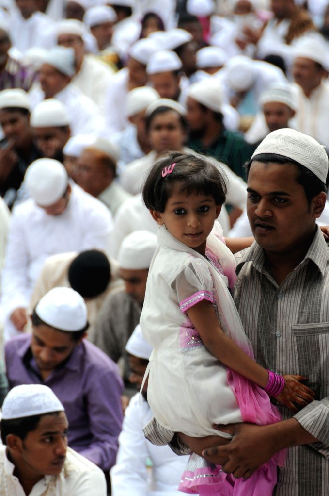 Muslims praying at Chamrajpet eidgah ground on the occasion of Eid ul-Fitr in Bangalore on August 9, 2013.
