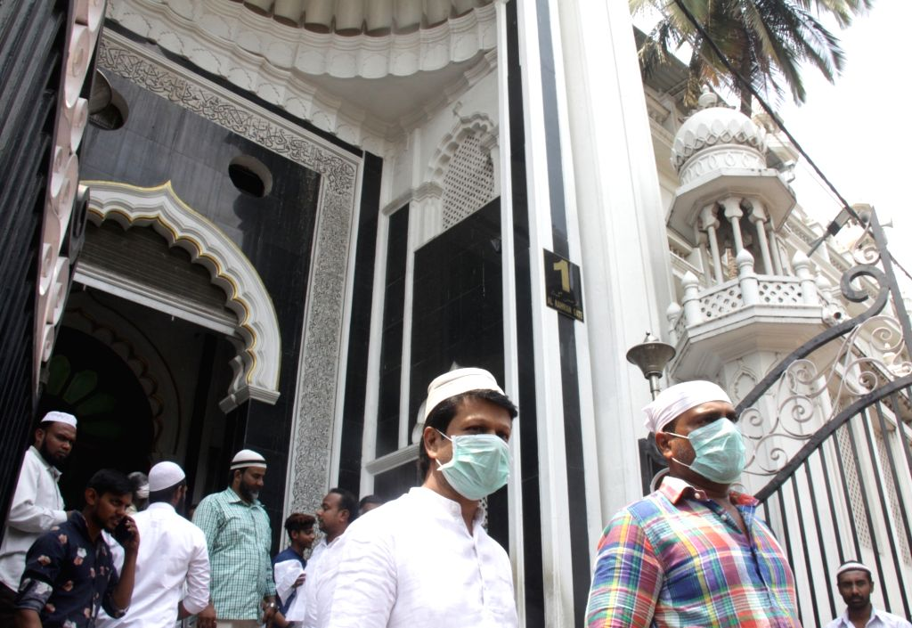 Muslims seen wearing masks during Friday prayers at a mosque amid COVID-19 (coronavirus) pandemic, in Bengaluru on March 20, 2020.