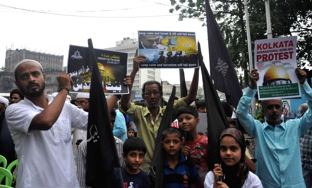 Muslims stage a demonstration against attack on Iran Parliament and holy shrines in the country, in Kolkata on June 23, 2017.