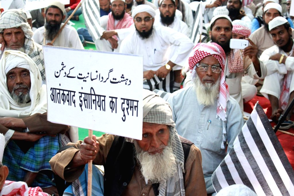 Muslims stage a demonstration condemning terrorism in New Delhi, on Nov 18, 2015.