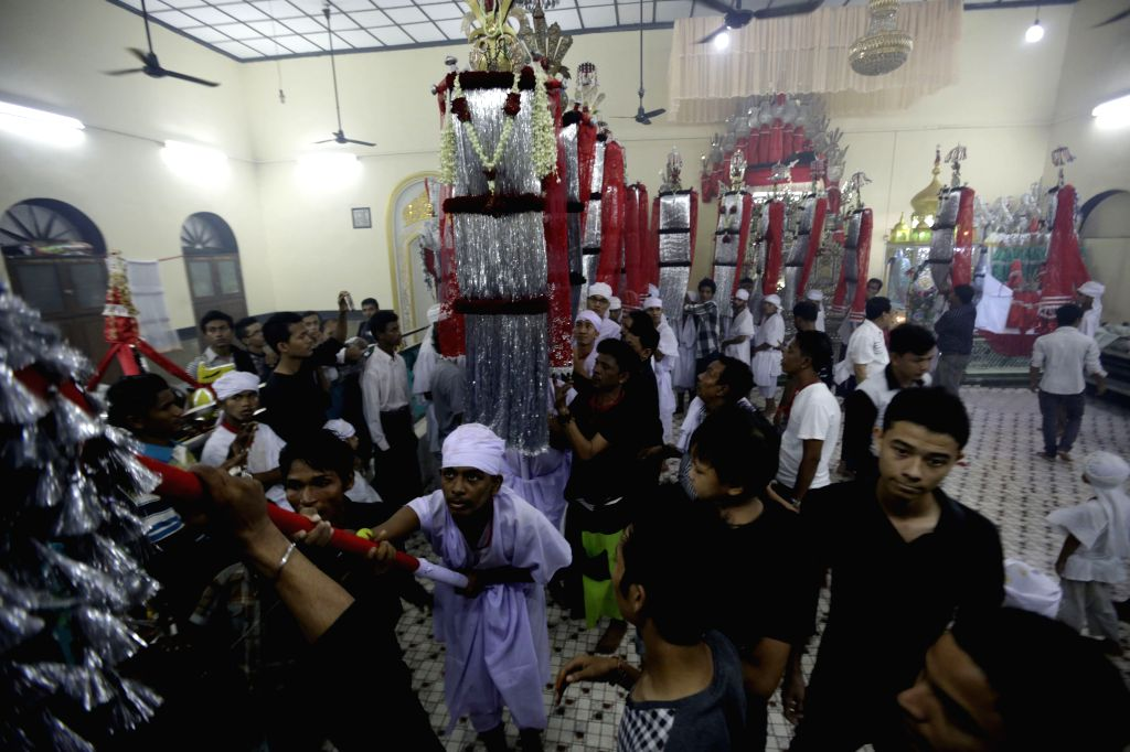 Muslims take part in a ceremony ahead of the coming Ashura at a mosque in Yangon, Myanmar, Oct. 21, 2015. Ashura, the 10th day of the Islamic month of Muharram, ...