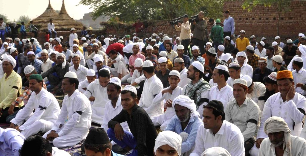 Muslims wear black arm bands in the home village of the Junaid Khan during prayers on the occasion of Eid-ul-Fitr in protest at the beef-related hate crime at Khandawali village in ... - Junaid Khan