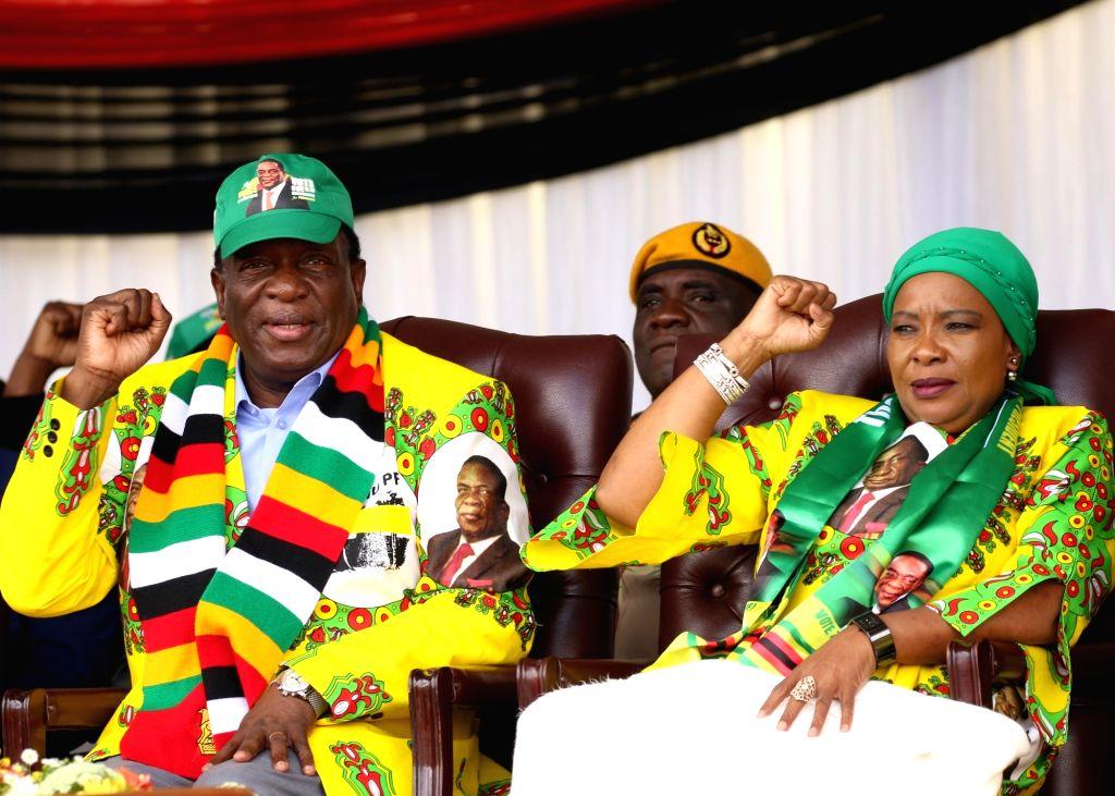 MUTARE (ZIMBABWE), May 19, 2018 Zimbabwean President Emmerson Mnangagwa (L) and his wife Auxillia Mnangagwa (R) attend a rally of ruling party ZANU-PF in Mutare, Zimbabwe, May 19, 2018. ...