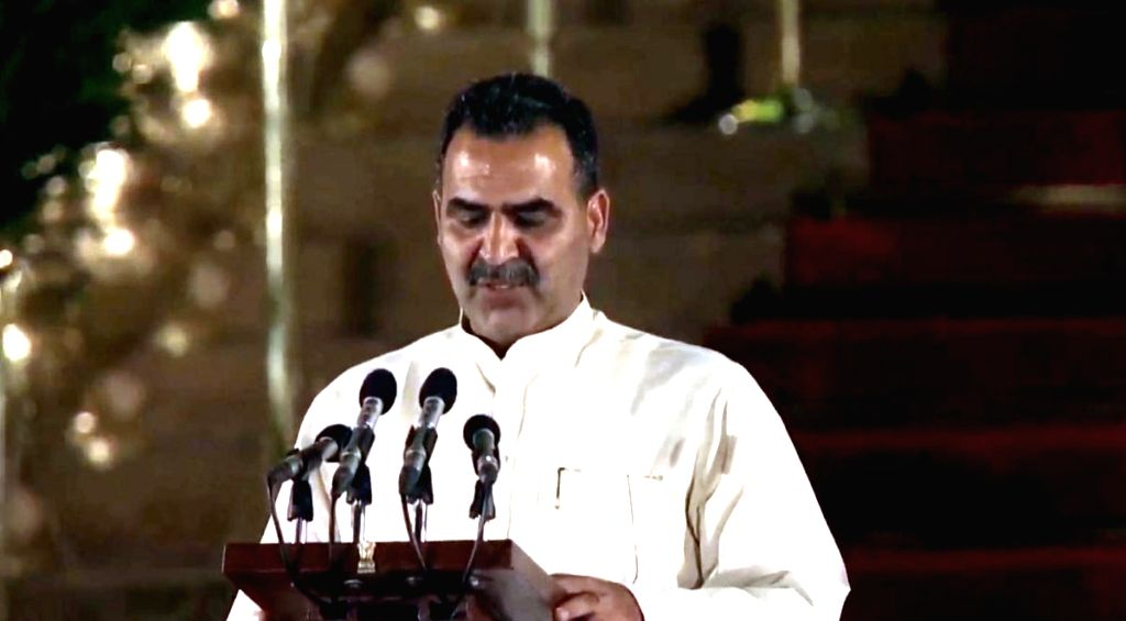 Muzaffarnagar BJP MP Sanjeev Kumar Balyan takes oath as Union Minister at a swearing-in ceremony at Rashtrapati Bhavan in New Delhi on May 30, 2019. - Sanjeev Kumar Balyan