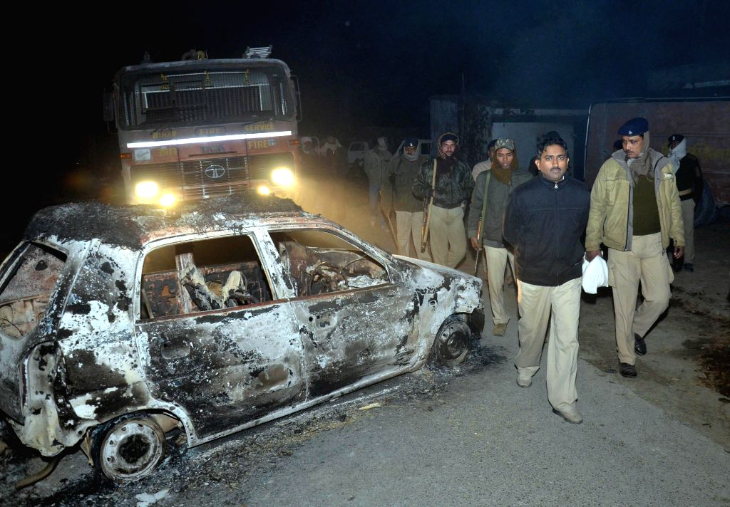 A police team visits the violence hit Ajitpur Bahilwara village of Bihar's Muzaffarpur district a day after three people were burnt to death and 10 were injured when a mob torched over ..