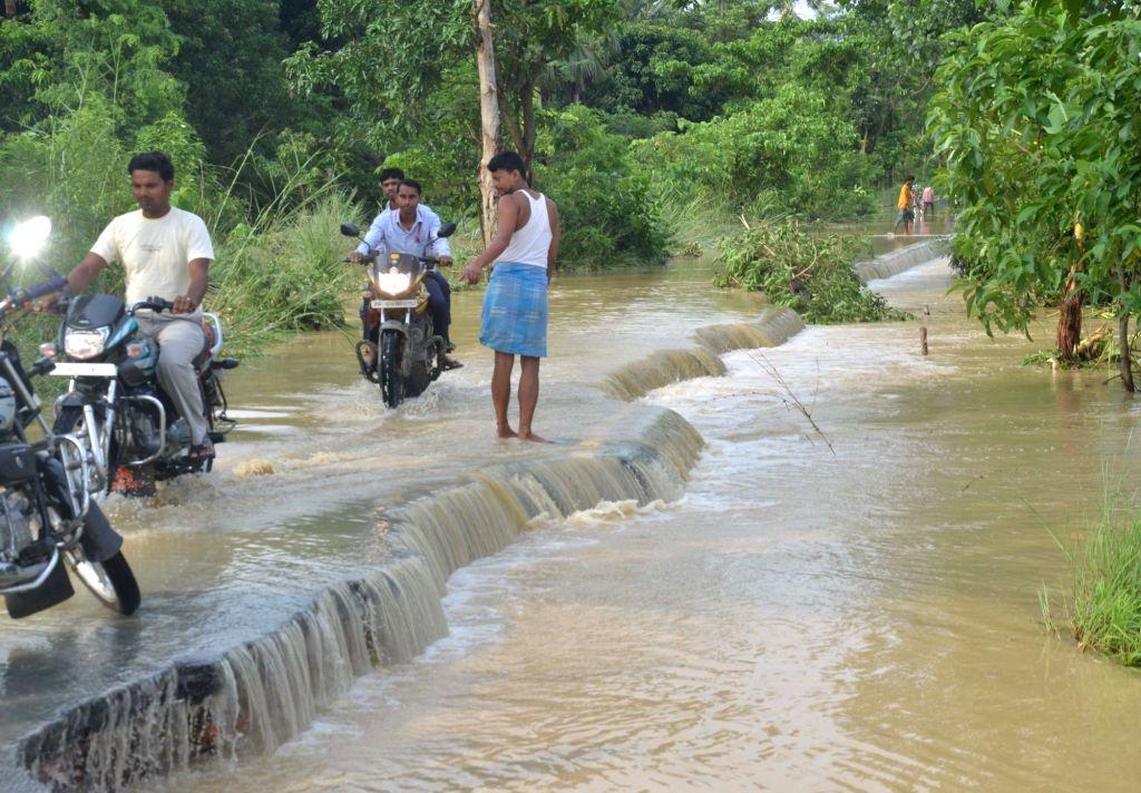 Muzaffarpur: A road destroyed by flood water in Katra block of Muzaffarpur on July 15, 2019. (Photo: IANS)