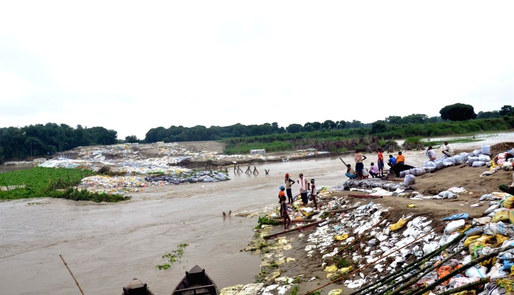 Muzaffarpur: Heavy rains leave a dam on the sub-section of Bagmati river, damaged inundating the Benipur Janarh village in Bihar's Muzaffarpur district, on July 9, 2019. (Photo: IANS)