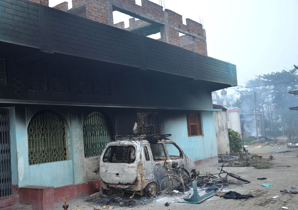 The charred remains of a car in violence hit Ajitpur Bahilwara village of Bihar's Muzaffarpur district a day after three people were burnt to death and 10 were injured when a mob torched