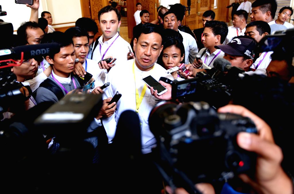 Myanmar Minister for Information and the presidential spokesperson U Ye Htut (C) speaks to the media after attending the 12th regular session of the Union ...