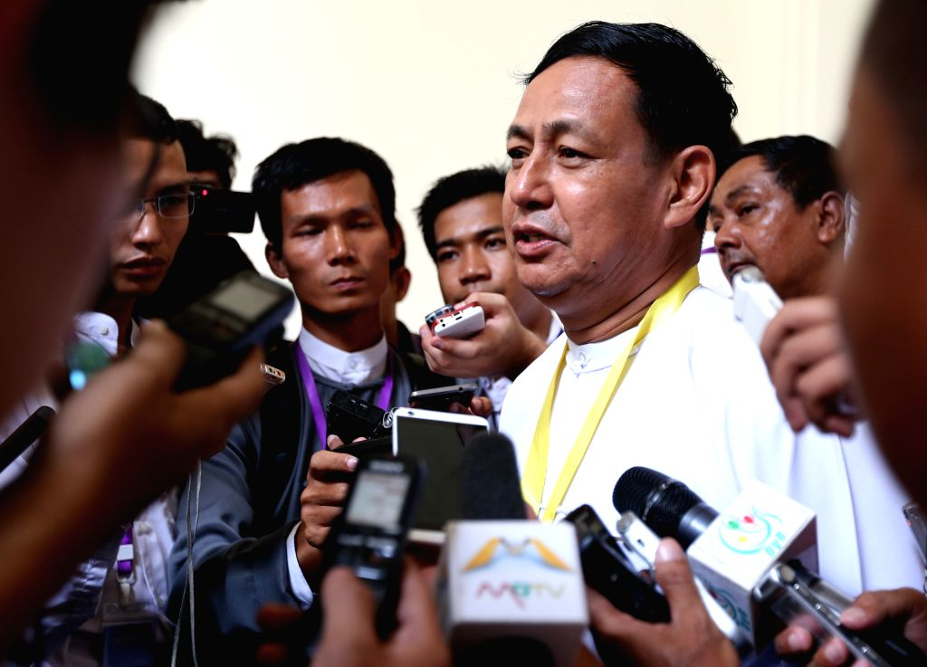 Myanmar Minister for Information and the presidential spokesperson U Ye Htut (2nd R) speaks to the media after attending the 12th regular session of the Union ...