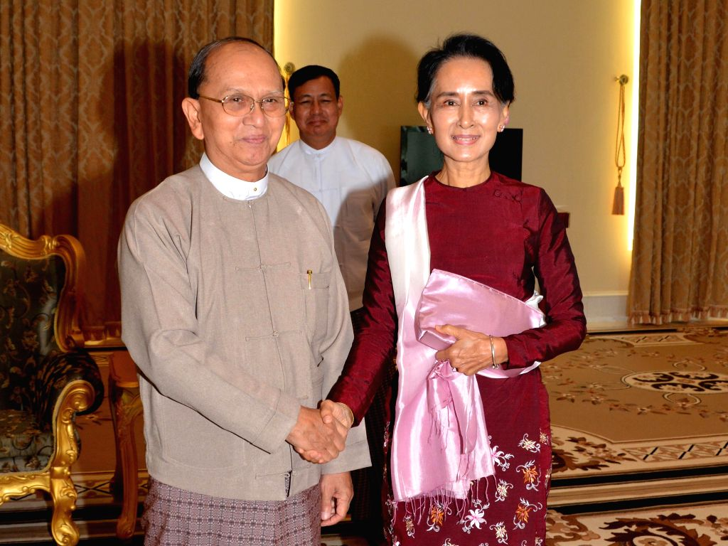 Myanmar President U Thein Sein (L) meets with Aung San Suu Kyi, chairperson of the election-winning opposition National League for Democracy, at the Presidential ...