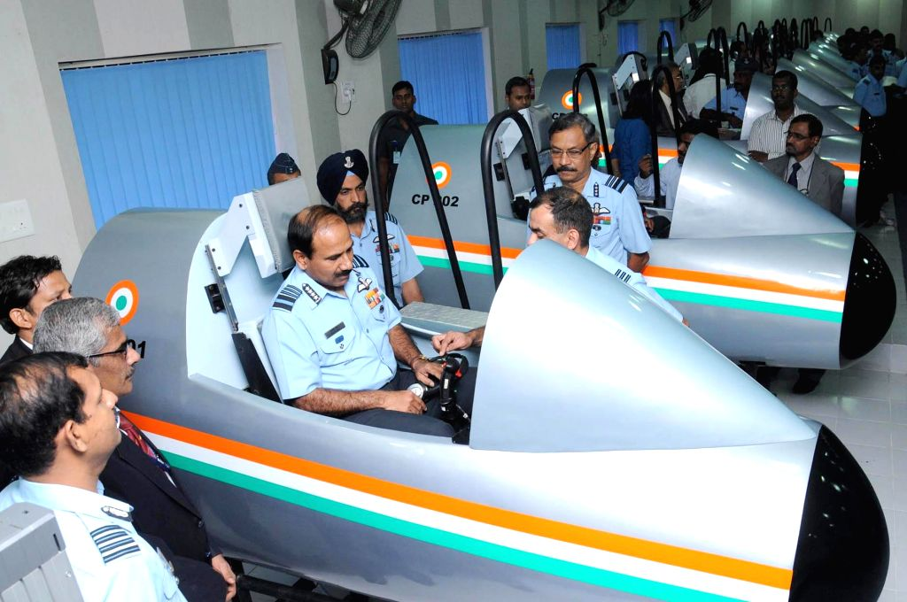Air Chief Marshal Arup Raha inspects the new pilot testing system, after the inauguration of Computerised Pilot Selection System (CPSS) developed jointly by the DRDO and IAF, at Air Force ...