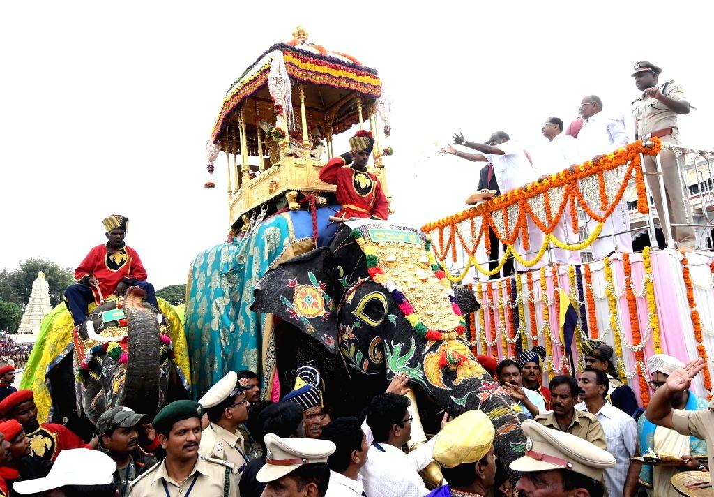 :Mysuru: Karnataka Chief Minister H. D. Kumaraswamy, Deputy Chief Minister G. Parameshwara and others during 'Jamboo Savari' procession a part of Mysuru Dasara Festival 2018, organised on ...