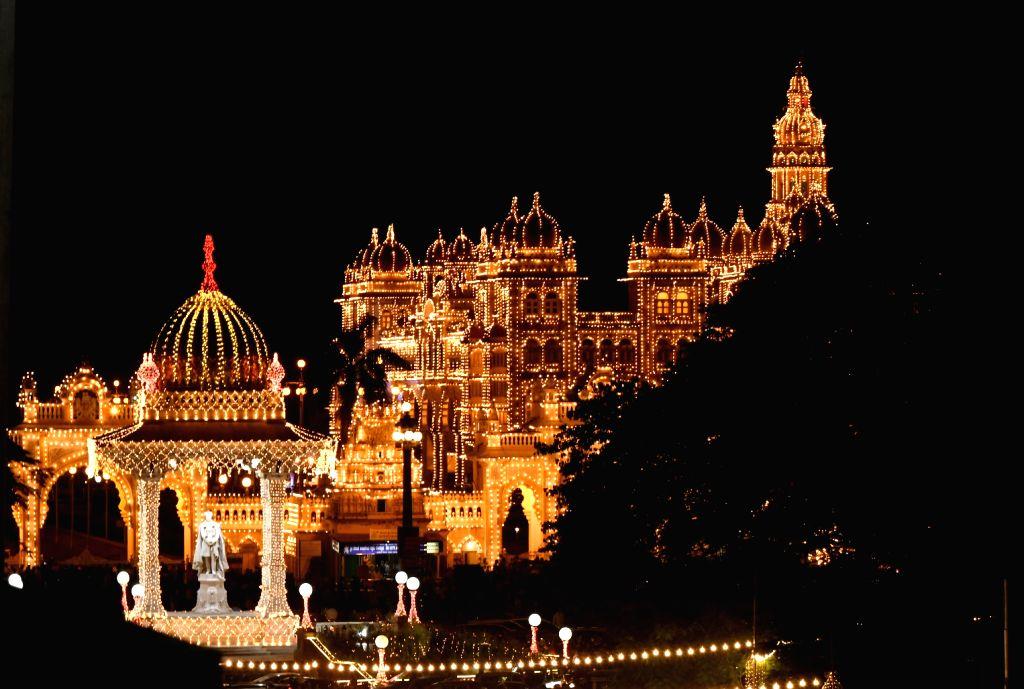 Mysuru Palace illuminated ahead of Dasara celebrations, on Oct 18, 2020.