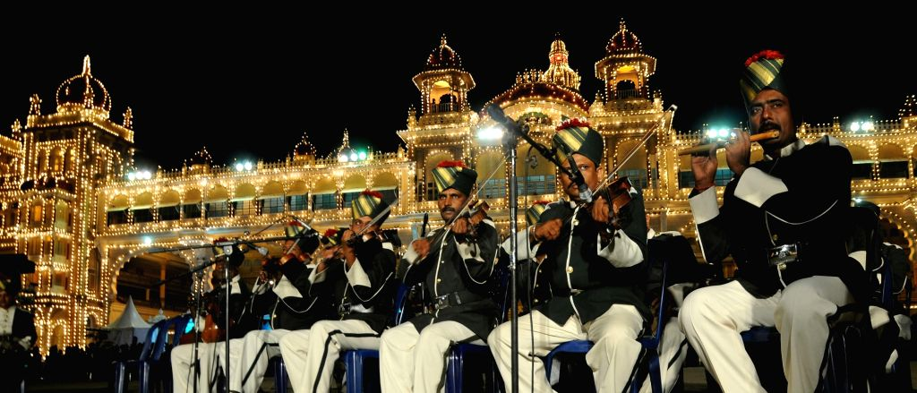 Mysuru police band enthralls crowd at Mysuru Palace as part of Dasara 2016 celebrations in Mysuru on Oct 6, 2016.