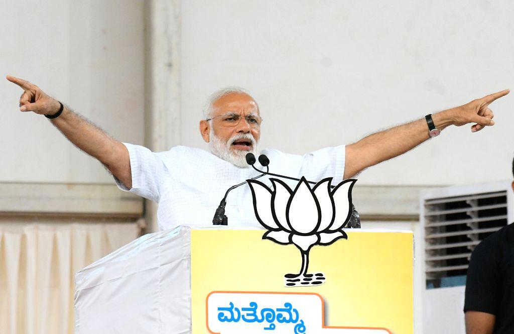 Mysuru: Prime Minister Narendra Modi addresses a public rally in Mysuru, Karnataka on April 9, 2019. (Photo: IANS) - Narendra Modi