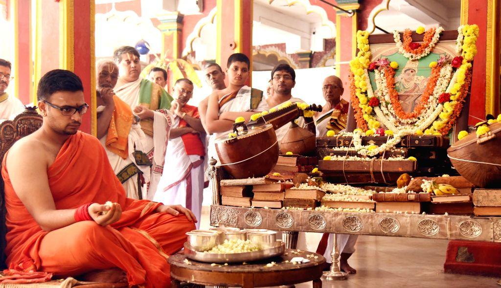 Mysuru royal dynasty's adopted scion Yaduveer Krishnadatta Chamaraja Wodiyar performs Saraswati Puja rituals during as a part of Dasara celebration at Mysuru Palace on Oct 7, 2016.