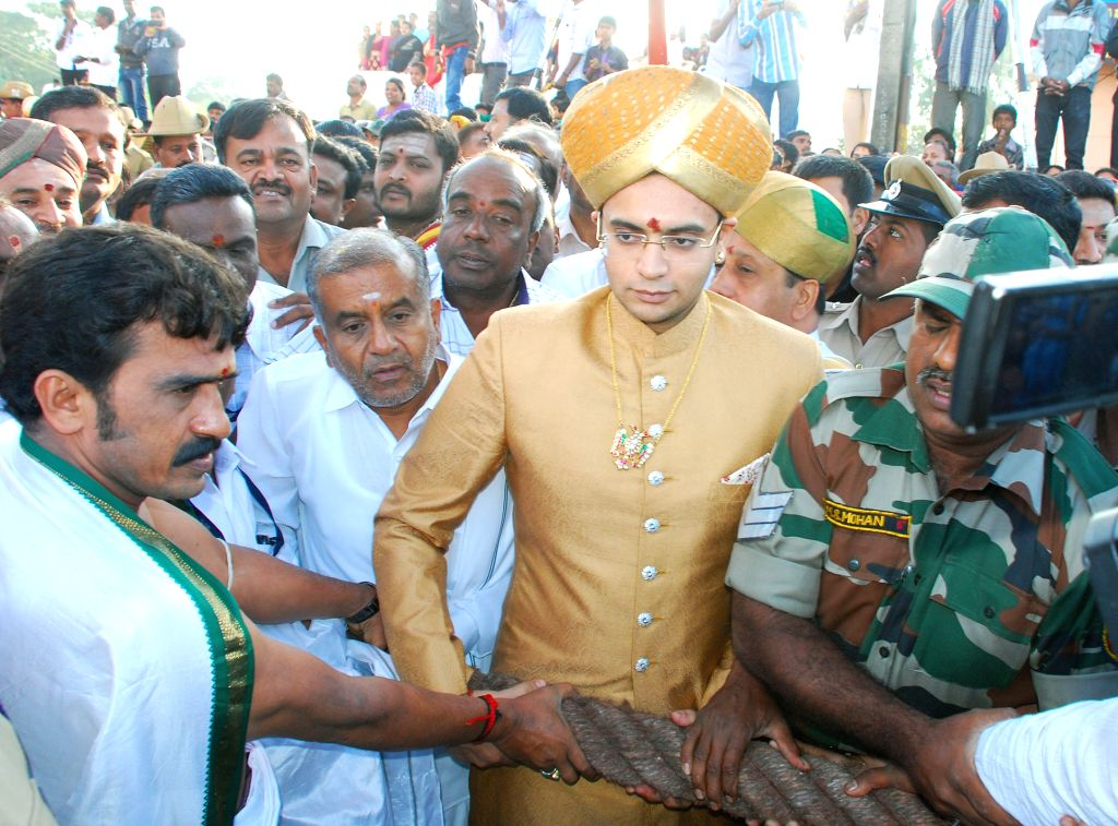 Mysuru's titular Maharaja Yaduveer Krishnadatta Chamaraja pulls the charriot during Chamundeshwari Rathotsava in Mysuru, on Oct 25, 2015.
