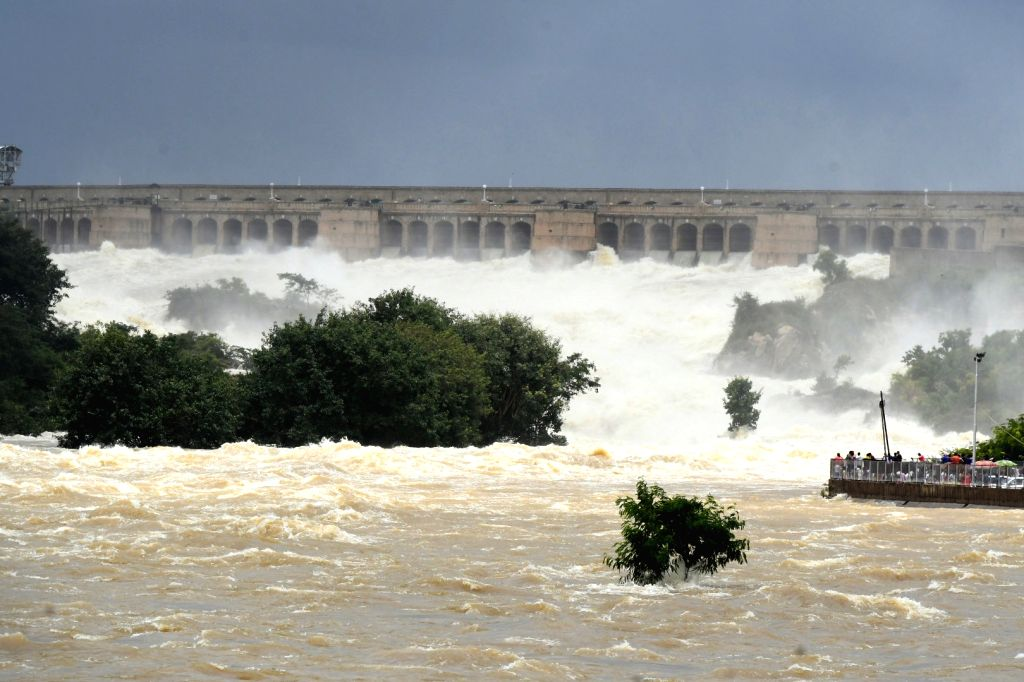 Mysuru: Water releases from the Krishnaraja Sagar (KSR) dam following the continues rains in the Cauvery catchment areas, in Mysuru on Aug 11, 2019. (Photo: IANS)