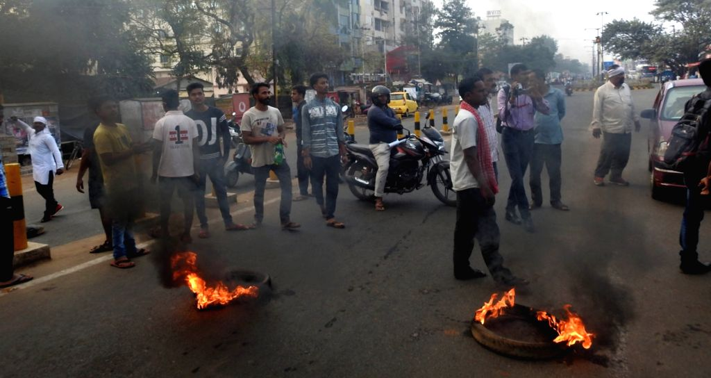 Naba Nirman Krushak Sangathan (NNKS) activists burn tyres to block road during a 12-hour bandh called by the organisation demanding price, prestige and pension for farmers in Odisha, on ...