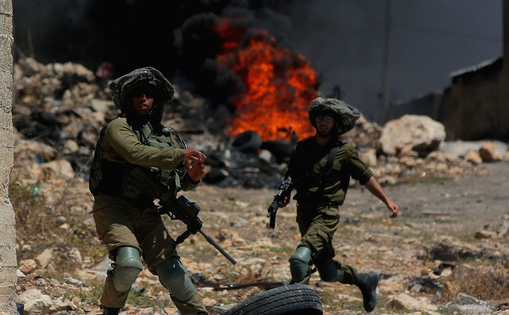 NABLUS, Aug. 9, 2019 - Israeli soldiers are seen during clashes with Palestinian protesters following a protest against the expansion of Jewish settlements in Kufr Qadoom village near the West Bank ...