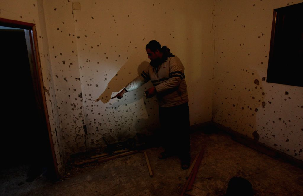 NABLUS, Dec. 13, 2018 - A Palestinian inspects the house where a Palestinian young man was shot dead by Israeli forces at Askar refugee camp near the West Bank city of Nablus, on Dec. 13, 2018. ...