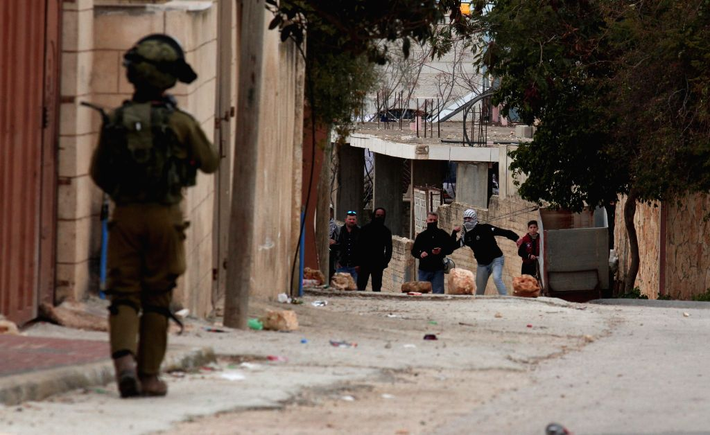 NABLUS, Feb. 1, 2019 - Palestinian protesters clash with Israeli soldiers after a protest against the expanding of Jewish settlements near the West Bank city of Nablus, on Feb. 1, 2019. Clashes broke ...