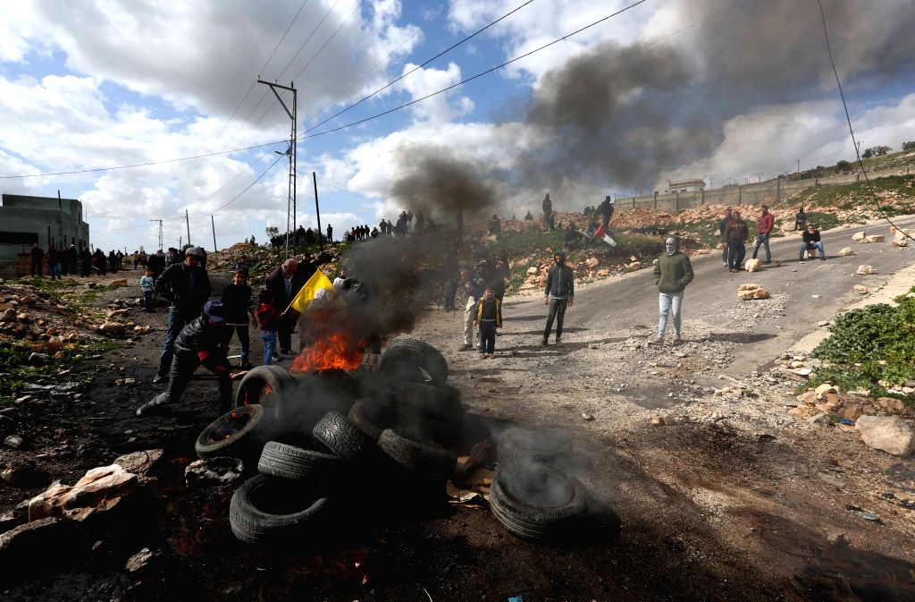 NABLUS, Feb. 8, 2019 - A Palestinian protesters burn tires during clashes with Israeli soldiers, after a protest against the expanding of Jewish settlements in Kufr Qadoom village near the West Bank ...