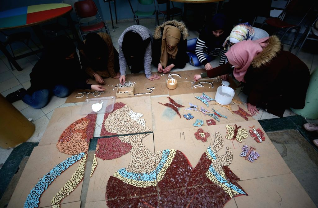 "NABLUS, March 14, 2019 - Young Palestinian girls work in making a mural titled ""The Lady of Spring"" at the Nablus Girls Rehabilitation Center in the West Bank city of Nablus, on Feb. 4, ..."