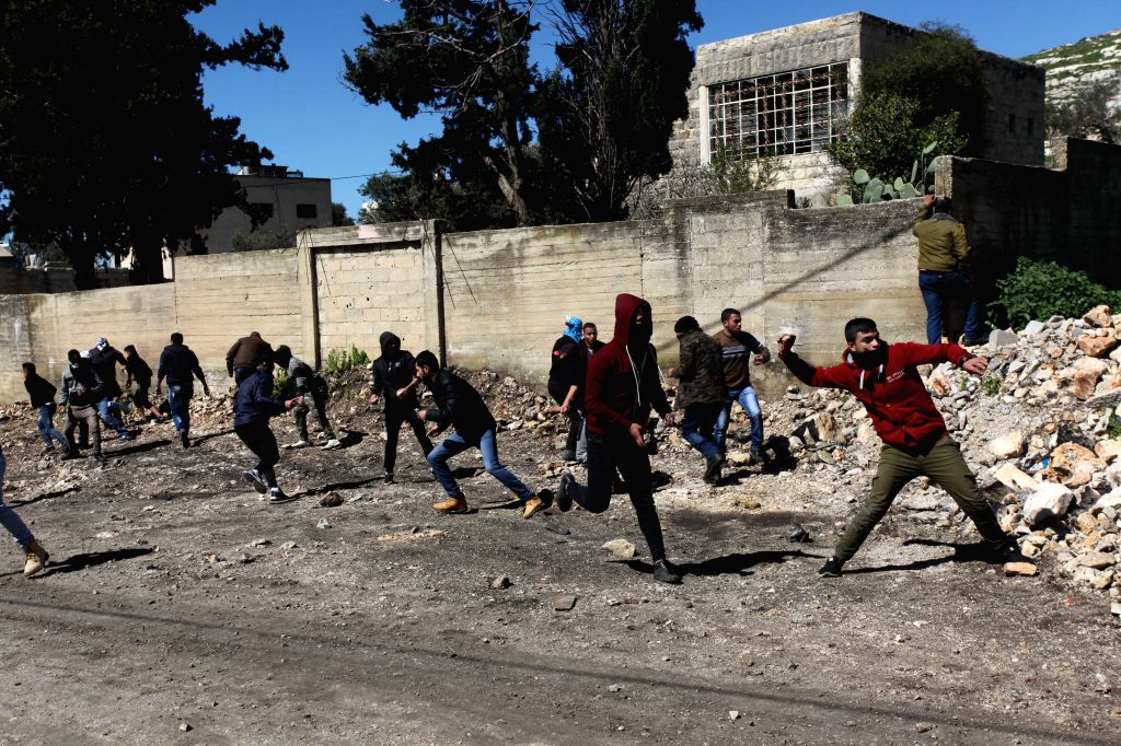 NABLUS, March 9, 2019 - Palestinian protesters hurl stones at Israeli soldiers during clashes, after a protest against the expanding of Jewish settlements in Kufr Qadoom village near the West Bank ...
