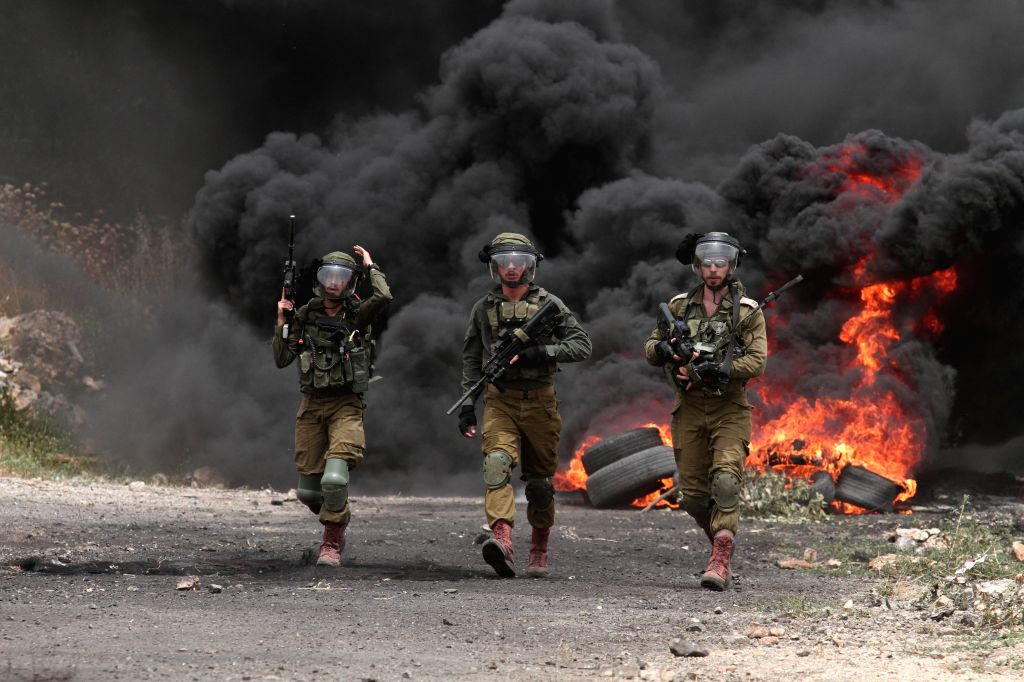 NABLUS, May 24, 2019 - Israeli soldiers hold their weapons during clashes with Palestinian protesters after a protest against the expanding of Jewish settlements in Kufr Qadoom village near the West ...