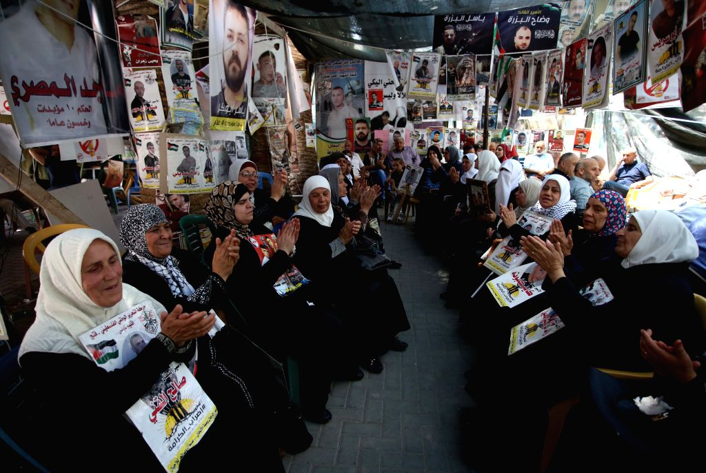 NABLUS, May 27, 2017 - Palestinian women hold pictures of their jailed families, as they celebrate during a protest in solidarity with prisoners in Israeli jails, in the West Bank City of Nablus, on ...