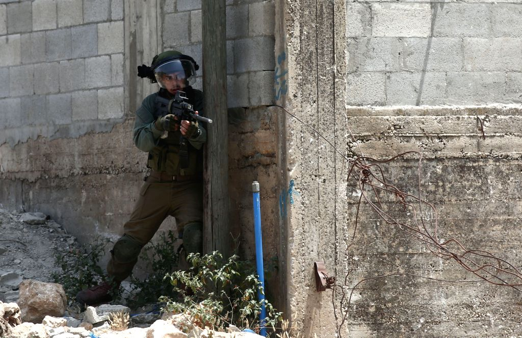 NABLUS, May 31, 2019 - An Israeli soldier reacts during clashes with Palestinian protesters after a protest against the expanding of Jewish settlements in Kufr Qadoom village near the West Bank city ...