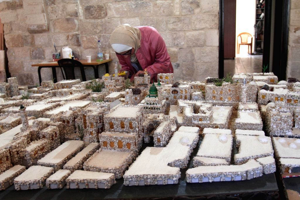 NABLUS, Nov. 1, 2018 - Palestinian artist Noura Jardaneh displays a miniature replica of the old city of Nablus with the goal of simplifying its routes for tourists and locals alike, in the West Bank ... - Noura Jardaneh