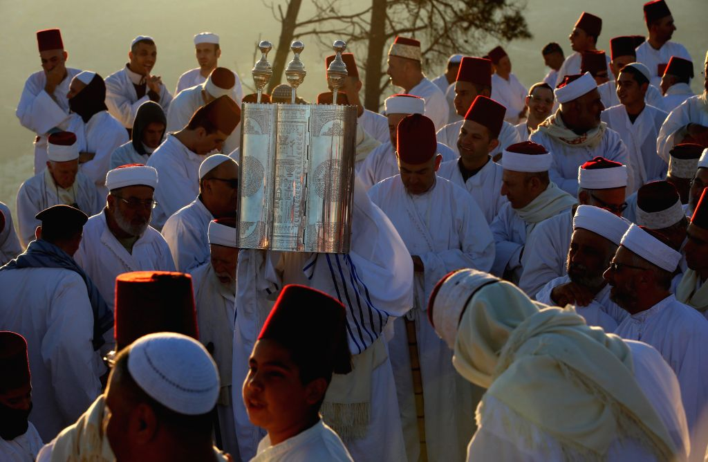 NABLUS, Oct. 4, 2017 - Samaritan take part in a traditional ceremony celebrating the Sukkot, the Feast of the Tabernacles, at their most sacred site in Mount Gerizim near the West Bank city of ...