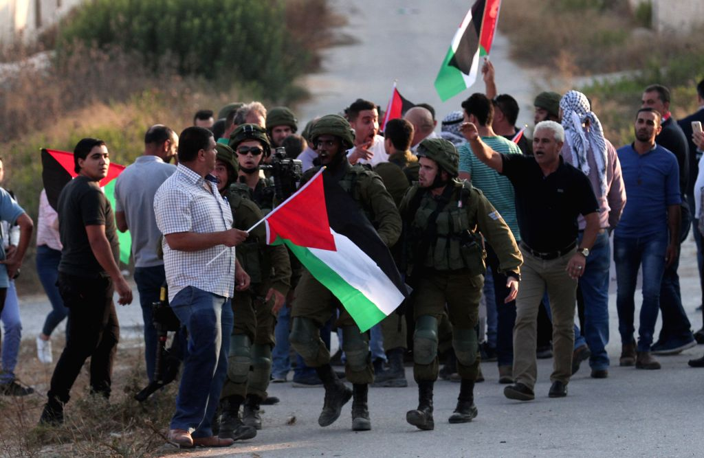 NABLUS, Sept. 4, 2019 - Palestinian protesters clash with Israeli soldiers during a protest against Israeli forces conducting exercises in a residential area, northwest of the West Bank city of ...